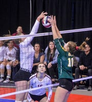 CMR's Tennisen Hiller battles Helena High's Caroline Bullock at the net during the third place match of the state volleyball tournament on Saturday in Bozeman.