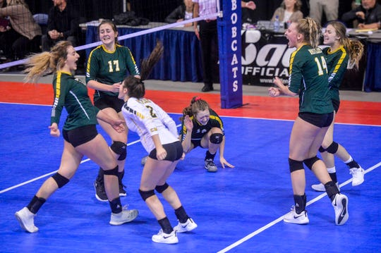 CMR celebrates a point in their third place match against Helena High during the state volleyball tournament on Saturday in Bozeman.