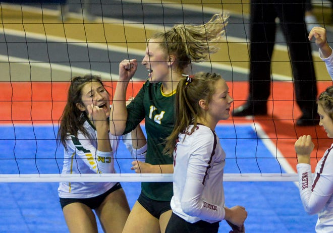 CMR's Allie Olsen celebrates a point Saturday's third place match against Helena High at the state volleyball tournament in Bozeman.
