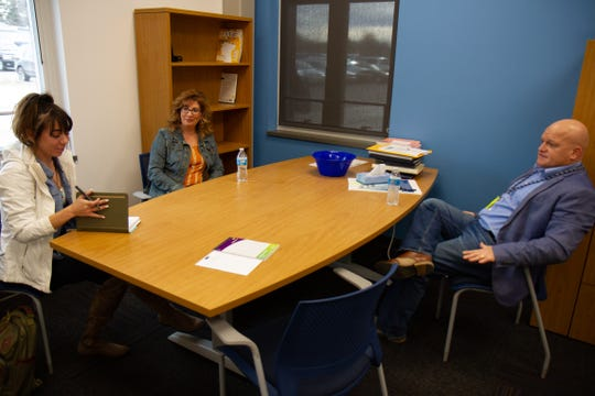 Sarah Gough, left, meets with Great Falls High School Principal Geoff Habel to discuss the school's needs with Kari Woods, who shadowed Habel for the second annual Business Goes to School event.