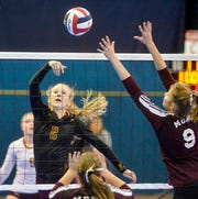 Belt's Lindsey Paulson tips at the net in Saturday's third place match at the state volleyball tournament in Bozeman.