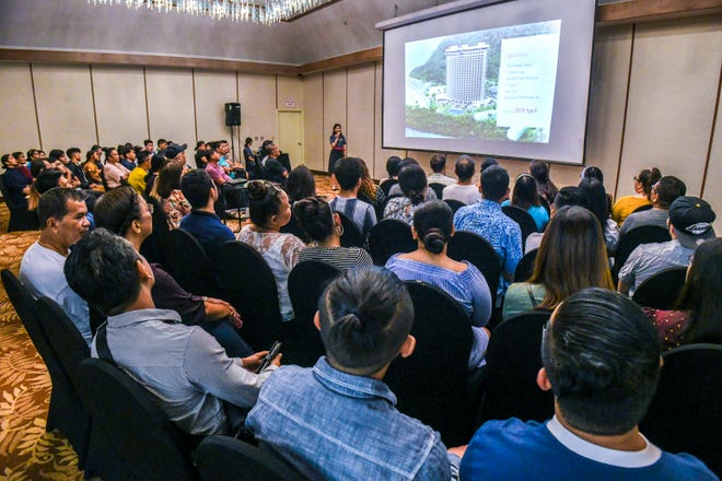 Public Relations Manager Mizuki Iwano, standing, briefs a room full of prospective job applicants on the features of The Tsubaki Towers and introduces the hotel's mission at a job fair at the Hotel Nikko Guam Saturday, Nov. 16, 2019. Organizers estimated over 1,000 applications have been submitted.