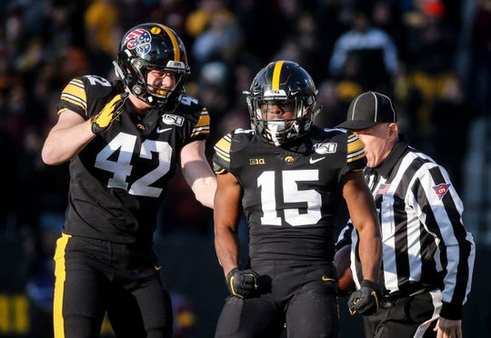 Tyler Goodson (13 carries, 94 yards vs. Minnesota), right, was an early difference-maker. So were the Hawkeye tight ends, a three-man group that included Shaun Beyer (42).