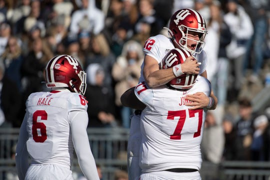 Indiana quarterback Peyton Ramsey (12) celebrates with offensive lineman Caleb Jones (77) after scoring a touchdown during the first quarter of NCAA college football game against Penn State in State College, Pa., on Saturday, Nov.16, 2019.
