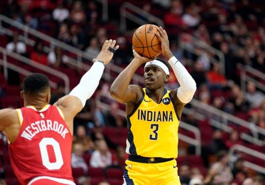 Indiana Pacers' Aaron Holiday (3) shoots as Houston Rockets' Russell Westbrook (0) defends during the first half of an NBA basketball game Friday, Nov. 15, 2019, in Houston.