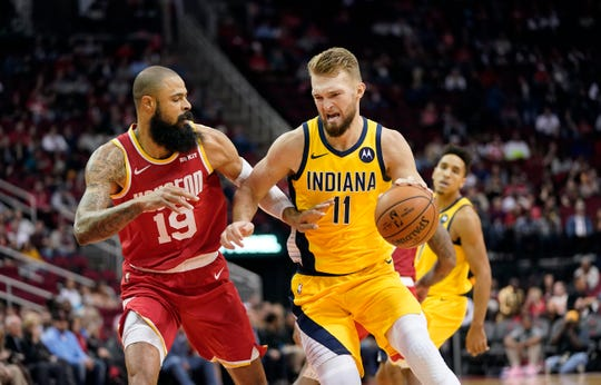 Indiana Pacers' Domantas Sabonis (11) drives toward the basket as Houston Rockets' Tyson Chandler (19) defends during the first half of an NBA basketball game Friday, Nov. 15, 2019, in Houston.