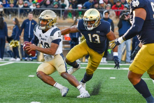 Nov 16, 2019; South Bend, IN, USA; Notre Dame Fighting Irish linebacker Paul Moala (13) pressures Navy Midshipmen quarterback Malcolm Perry (10) in the second quarter at Notre Dame Stadium.
