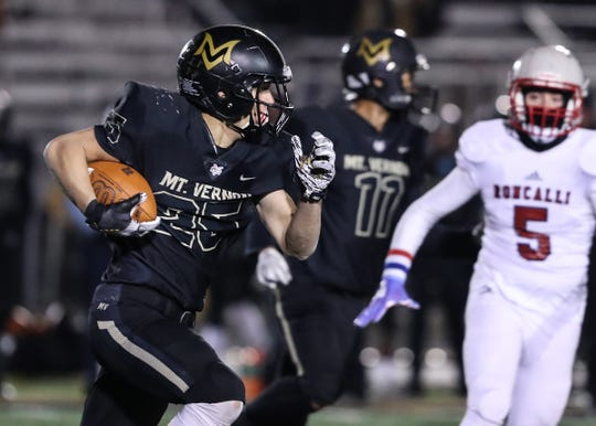 Mt. Vernon's Rylan Cole (25) runs the ball against Roncalli in the first half of the regional final game at Mt. Vernon High School in Fortville, Ind., Friday, Nov. 15, 2019.