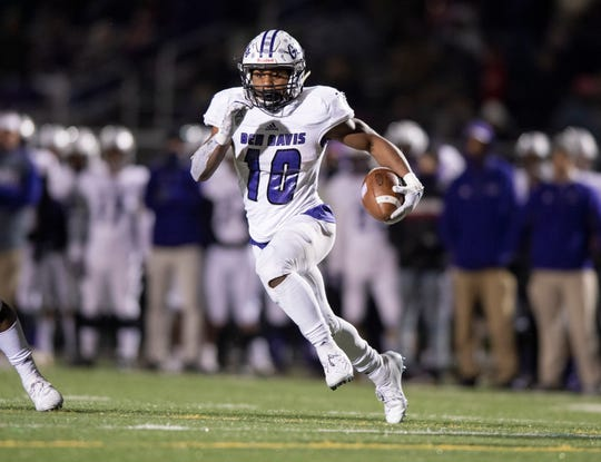 Ben Davis High School senior Alijawon Hassel (10) rushes the ball up field during the first half of action. Zionsville High School hosted Ben Davis High School in a IHSAA Class 6A Regional Championship, Friday, Nov. 15, 2019.