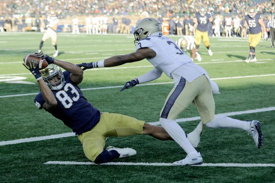 Notre Dame wide receiver Chase Claypool (83) makes a touchdown reception against Navy cornerback Cameron Kinley (3) during the first half of an NCAA college football game, Saturday, Nov. 16, 2019, in South Bend, Ind.