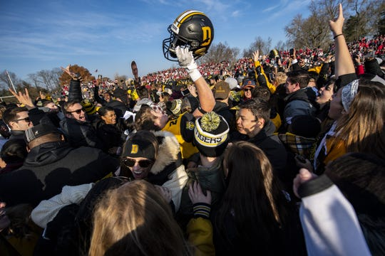 DePauw fans rush the field after their victory of the Monon Bell Game, Saturday, Nov. 16, 2019, in Greencastle, Ind. DePauw won the game 17-13 to take the Monon Bell from Wabash.