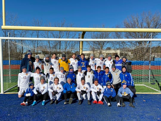 Lansing boys soccer team poses after its 4-0 victory in the state semifinal on Saturday morning.