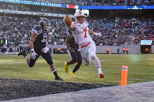 SUNY Cortland senior running back Zach Tripodi runs the ball into the end zone on Saturday against Ithaca at MetLife Stadium.