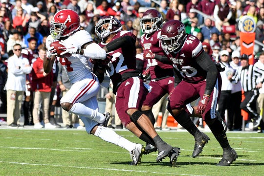 Nov 16, 2019; Starkville, MS, USA;Alabama Crimson Tide wide receiver Jerry Jeudy (4) makes a reception while defended by Mississippi State Bulldogs safety Brian Cole II (32) during the first quarter at Davis Wade Stadium. Mandatory Credit: Matt Bush-USA TODAY Sports