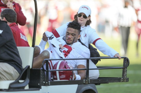 Alabama quarterback Tua Tagovailoa is carted off the field after injuring his hip.