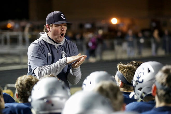 Central Catholic head coach Brian Nay talks to the team during halftime in the IHSAA class A regional championship football championship, Friday, Nov. 15, 2019 in Lafayette.