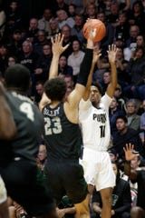 Purdue guard Isaiah Thompson (11) goes up for three over Chicago State forward Jace Colley (23) during the first half of an NCAA Men's basketball game, Saturday, Nov. 16, 2019 at Mackey Arena in West Lafayette.