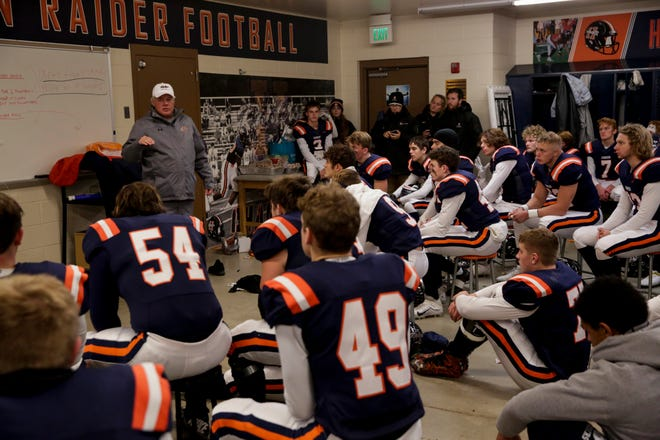 Harrison head coach Terry Peebles talks to his team inside the locker room prior to the start of the IHSAA class 5A regional championship football championship, Friday, Nov. 15, 2019 in West Lafayette.