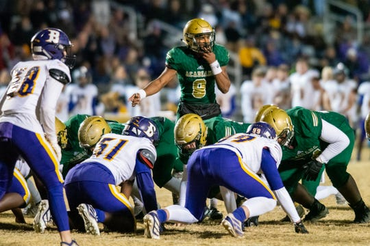 Acadiana High quarterback Keontae Williams directs his teammates before the play as the Wreckin' Rams take on the Benton High Tigers in the first round of the LHSAA football playoffs on Friday, Nov. 15, 2019.