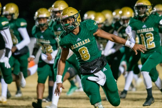 Acadiana High's Keontae Williams runs onto the field after halftime as the Wreckin' Rams take on the Benton High Tigers in the first round of the LHSAA football playoffs on Friday, Nov. 15, 2019.