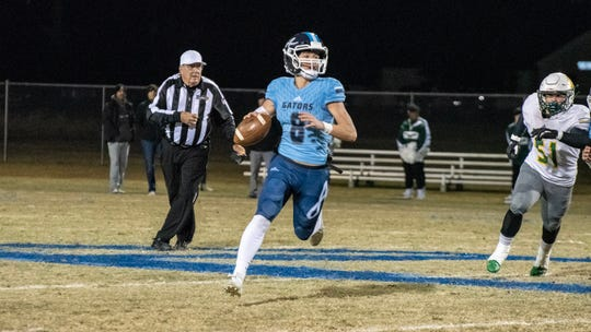 Ascension Episcopal quarterback Cole Simon runs the ball down the field as the Blue Gators take on the Holy Savior Menard Eagles in the first round of the LHSAA football playoffs Friday, Nov. 15, 2019.