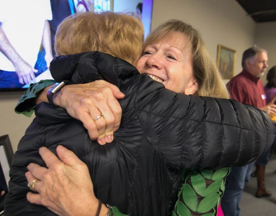 Katherine Janego gets a hug from Judy Stover, a former Love, INC staff member, as Janego says farewell on her last day Friday, Nov. 15, 2019. Janego is retiring after 13 years as executive director of Love, INC.