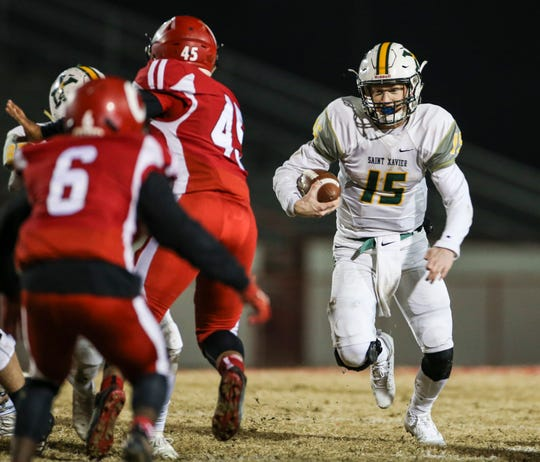 St. X's Douglas Bodhaine runs for yardage against Manual in the Class 6A Playoffs Friday night at Manual's Memorial Stadium. Nov. 15, 2019