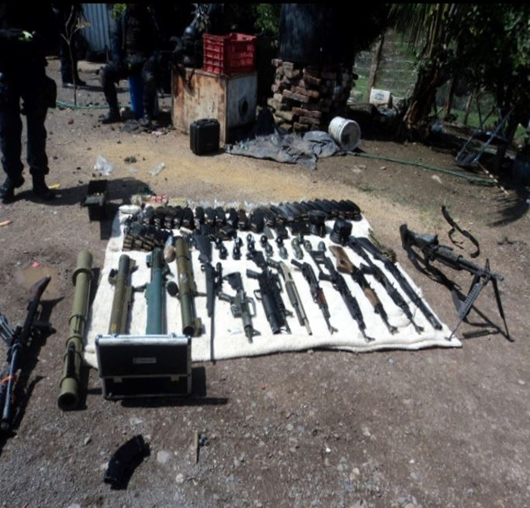 Weapons seized at the compound in rural Jalisco, where El Mencho narrowly escaped. Information from a Gulfport, Mississippi case led to the raid in 2012.