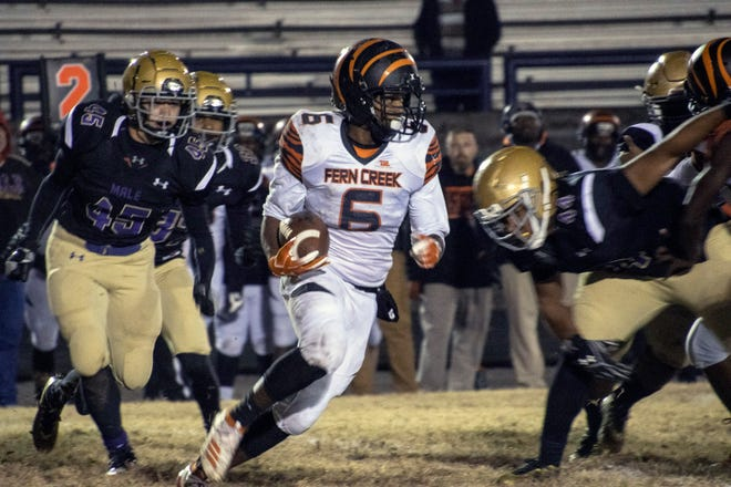 Fern Creek's Terrance Mitchell looks for room to run against the Male defense on Friday night in a 6A playoff matchup. 11/15/19