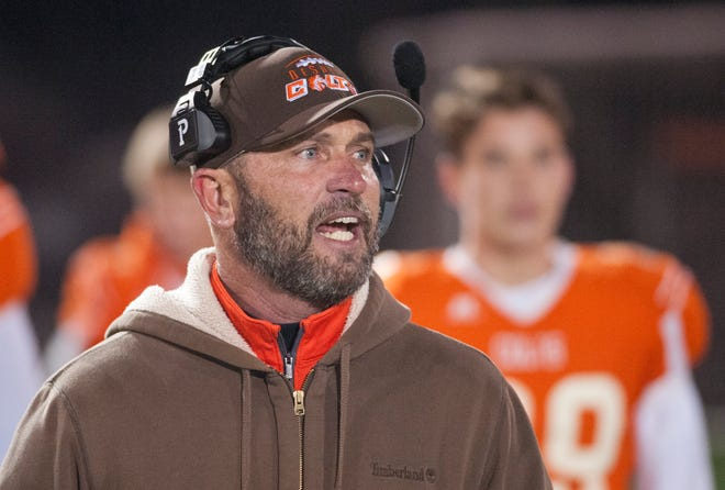 DeSales head football coach Harold Davis shouts instructions to his team on the field.15 November 2019