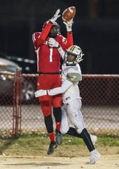 Manual wide receiver Eli Blakey tried to stay in bounds for the end zone catch but was pushed out by St. X's Anthony Woods in the second round of the 6A playoffs. Nov. 15, 2019