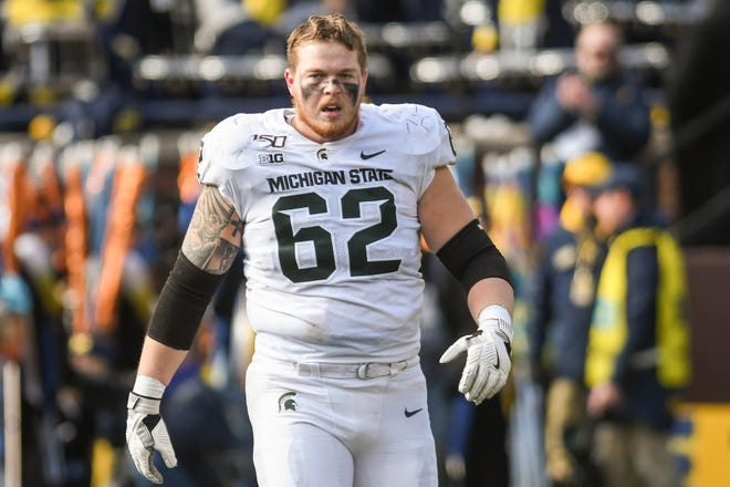 MSU's Luke Campbell walks off the field after being injured in Ann Arbor in November of 2019. He played his first game since last Friday at Northwestern.