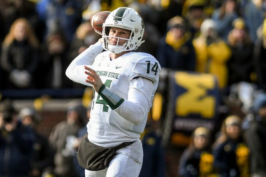 Michigan State's Brian Lewerke throws a pass during the second quarter on Saturday, Nov. 16, 2019, at Michigan Stadium in Ann Arbor. When the Spartans return for their final home game Nov. 30, tickets are selling for as little as $5.