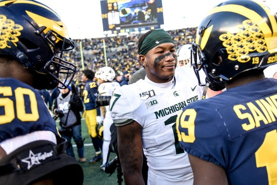 Michigan State's Tyriq Thompson, center, and Michigan's Mike Sainristil, right, talk trash to each other after the game on Saturday, Nov. 16, 2019, at Michigan Stadium in Ann Arbor. Michigan beat Michigan State 44-10.