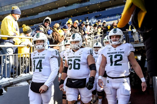 From left, Michigan State's Brian Lewerke, Blake Bueter and Rocky Lombardi take the fieldbefore the game on Saturday, Nov. 16, 2019, at Michigan Stadium in Ann Arbor.