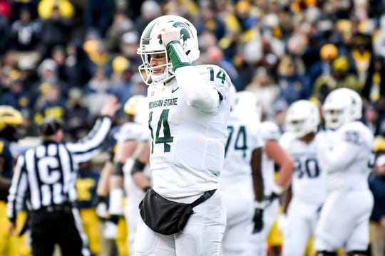 Michigan State's Brian Lewerke walks off the field after failing to convert during the fourth quarter on Saturday, Nov. 16, 2019, at Michigan Stadium in Ann Arbor.
