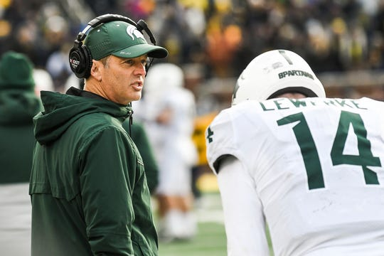 Michigan State's offensive coordinator Brad Salem, left, talks with quarterback Brian Lewerke during the fourth quarter on Saturday, Nov. 16, 2019, at Michigan Stadium in Ann Arbor.
