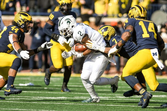Michigan State's Julian Barnett catches a pass as Michigan's Khaleke makes the tackle during the second quarter on Saturday, Nov. 16, 2019, at Michigan Stadium in Ann Arbor.