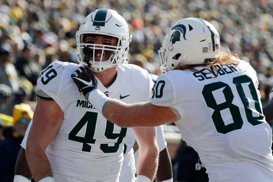 Nov 16, 2019; Ann Arbor, MI, USA; Michigan State Spartans fullback Max Rosenthal (49) is congratulated by tight end Matt Seybert (80) after scoring a touchdown against the Michigan Wolverines in the first half at Michigan Stadium. Mandatory Credit: Rick Osentoski-USA TODAY Sports