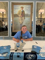 Former Lexington resident Nicole Adam signs her national letter of intent to play golf for North Carolina