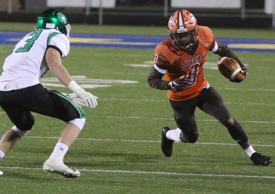 Mansfield Senior's Angelo Grose caught a touchdown and ran for another in a win over Holy Name.