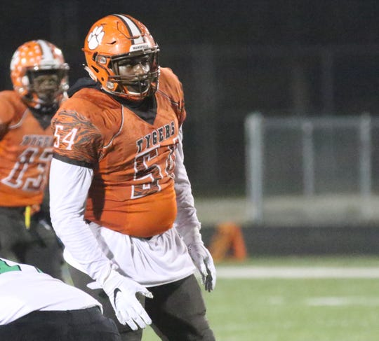 Mansfield Senior's Anthony Hawkins led a defensive front that led the Tygers to a 45-30 win over Holy Name.