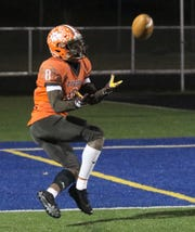 Mansfield Senior's Angelo Grose hauls in a 45-yard touchdown pass right before halftime in the Tygers' 45-30 win over Parma Holy Name on Friday night at Wooster High School. The Tygers move on to play in the program's first regional championship.