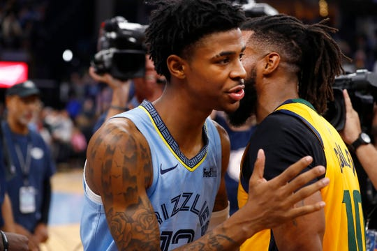 Memphis Grizzlies guard Ja Morant and Utah Jazz guard Mike Conley embrace after the Grizzlies 107-106 win at the FedExForum on Friday, Nov. 15, 2019.
