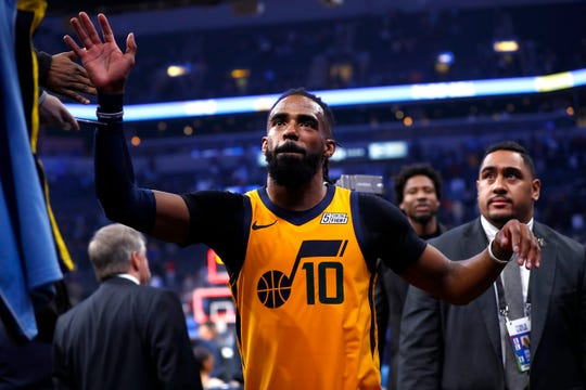 Utah Jazz guard Mike Conley high-fives fans on his way out of the FedExForum on Friday, Nov. 15, 2019.
