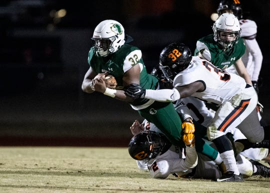 Briarcrest running back Marlon Hampton (32) is stopped by Ensworth free safety Andre Turrentine (2) and running back Toleo Malone (32) during a game in Eads, Tenn., Friday Nov.15, 2019.