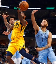 Memphis Grizzlies forward Kyle Anderson blocks a shot by Utah Jazz forward Royce O'Neale during their game at the FedExForum on Friday, Nov. 15, 2019.