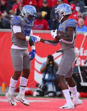 Memphis wide receiver Damonte Coxie, right, celebrates his touchdown with Kenneth Gainwell during the first half of an NCAA college football game against Houston, Saturday, Nov. 16, 2019, in Houston. (AP Photo/Eric Christian Smith)