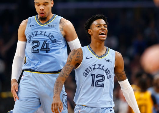 Memphis Grizzlies guards Ja Morant and Dillon Brooks celebrate a defensive stop against the Utah Jazz guard during their game at the FedExForum on Friday, Nov. 15, 2019.