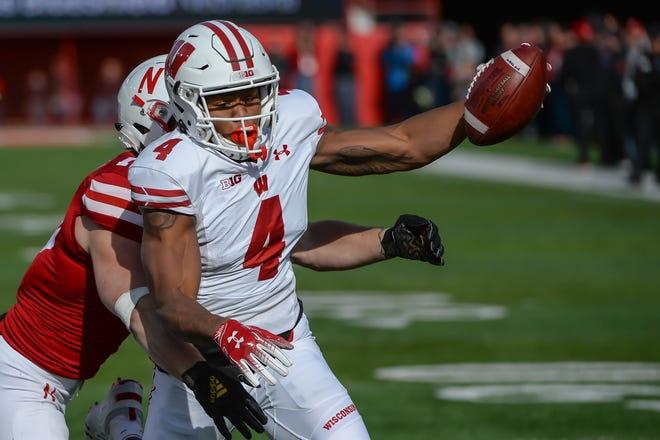 Wisconsin wide receiver A.J. Taylor scores as Nebraska linebacker JoJo Domann attempts a tackle at Memorial Stadium Saturday in Lincoln, Nebraska.